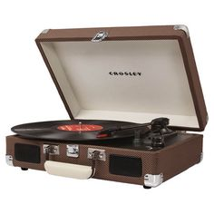 Featuring built-in stereo speakers and a classic tweed-hued finish, this portable 3-speed turntable brings a vintage-inspired look to your living room or den...