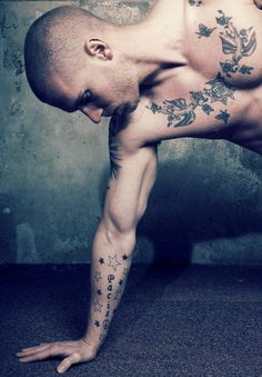 """Tense."" Muscle tease. Tattoo, body art."