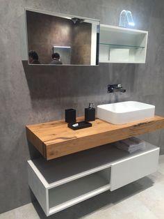 plan de travail de salle de bain en bois et meuble blanc avec rangements au-dessous