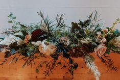 Wedding centerpiece with thistle, agonis, pampas and roses. Amazing fall colors and textures!