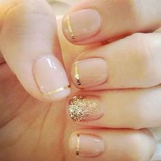 Golden Accents: Consider spicing up a nude manicure with these gold accents. The minimal stripes and glitter statement nail are just the right amount of 'Wow' to change your everyday look to your wedding day look.