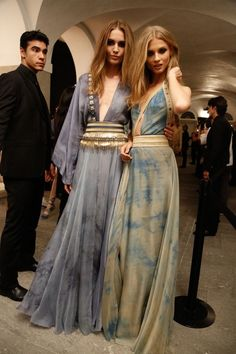 Love the dress on the left. Hippie boho chic