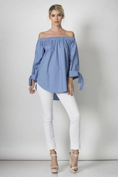 The Sail Away blouse features an off-shoulder neckline and loose, long sleeves with ties at the wrist.  95% Cotton / 5% Spandex    Expected to ship to Brass & Barrel on or about March 11th.