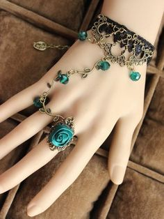 Black Lace Bracelet with sea green beads and rose ring.   Buy this @ Jumkey.com - http://jumkey.com/shop/all-bracelets-bracelets/black-lace-bracelet-with-sea-green-beads-and-rose-ring/