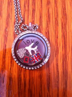 South Hill Designs - Travel inspired locket. Once travel is over, place in new charms for a new design. 100s of charms to choose from.