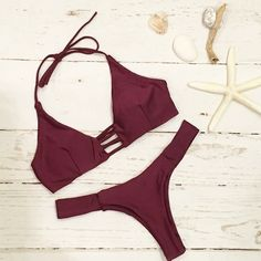 Don't we all love a sexy bikini? This beautiful burgundy bikini features a halter tie string top with strap detailing in back. The brazilian cut bottoms are extra cheeky and perfect to wear on the bea