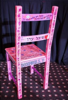 Use a horah chair for the guest book at your bat mitzvah. This one was decorated for someone's bat mitzvah.