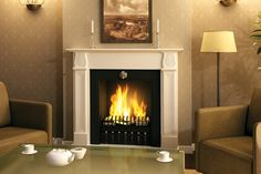 Compared to A-02, the A-03 insert is wider, fitting perfectly into bigger fireplaces. The hearth has a capacity of 1,7 litres of Fanola® liquid and a shutter enabling flame size regulation. A burner fully filled with Fanola® gives up to 6 hours burning time. Decorative metal bars which are fixed at the front of the insert enable ceramic log placement.