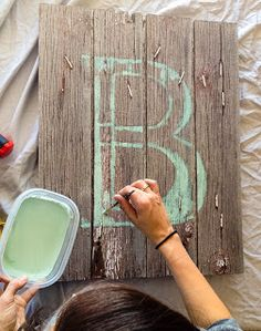 Totally want to do this!! Wonder where you can get cheap barnwood?? barnboard monogram
