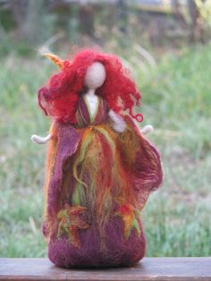 Lovely fall- autumn fairy, full of strong and vibrant colors. Needle felted art doll. Waldorf inspired- without details of her face. Nature table decoration. Tall about 8 You are welcome to my shop to see more of my fairies and dolls. Thank you for your visit. Original Design by Zuzana Hochman