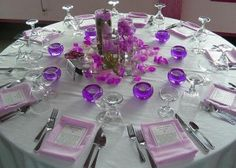 Close to what the tables will look like at our wedding! Minus pink and flowers and add more purple and sparkle!