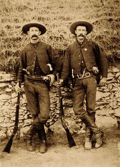 """Texas Ranger Cpl. J. Walter Durbin (at right) said he had some 15 good men in Company D, though a few could be a """"little fussy and dangerous"""" when drinking. Private Wood Saunders (at left) measured up splendidly—on both counts. This is one of my favorite photos because it shows how both Rangers carried their six-shooter Colts just forward of the hip, butt to the front, easily permitting a strong-hand cross draw. Courtesy Nita Stewart Haley Memorial Library J. Evetts Haley History Center"""