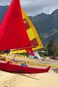 Outrigger sailing canoes on the beach at Hanalei Bay, Kauai North Shore, Hawaii.