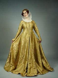 Cloth of gold gown based on the gowns of French queens from the first half of the 1400s.