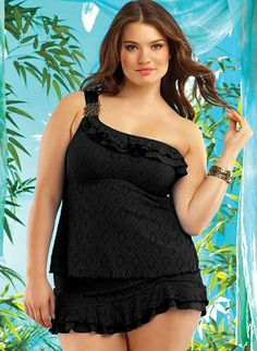 Black crochet one-shoulder A-line tankini top with ruffle trim along top and gold floral detail on strap. Black skirted bottom with crochet overlay and tiered ruffle detail along hem by Becca ETC by Rebecca Virtue Swimwear, $216.00