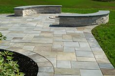 New York bluestone walk and patio leading to a seat wall and fire pit built using Eden limestone.