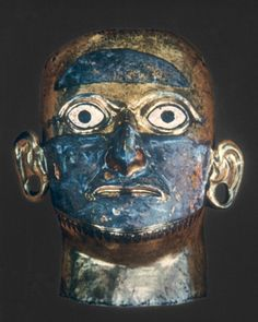 Death mask from Moon Pyramid. Gold  copper alloy w/silver plate, Moche culture, Peru.