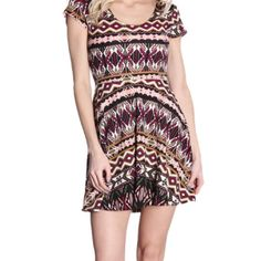 Sale! Multi color skater dress This dress is a multi color tribal print skater dress. Comes in small and large. 97% polyester and 3% spandex. Great comfort and stretchy.       Small measurements are length 31 1/2, bust 28 inches, and waist 27 inches. Large measurements are length 33 inches, bust 31 inches, and waist 14 inches. Keep in mind the 3% spandex for 3-4 inches of stretch! Smoke free home, Fast shipping, and discounts on bundles! Planet Gold Dresses Midi
