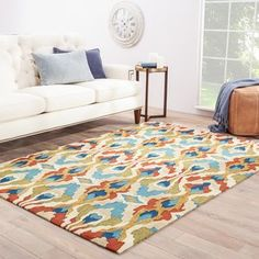 A contemporary expression of a global-inspired ikat design, this vibrant area rug makes a bold color statement in on-trend homes. Perfect for high-traffic areas, the durable looped pile offers plush feel un #rug #area #vibrant