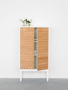 Cabinet with leather tiles by Swedish designer Sara Larsson
