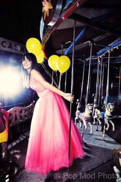 Pretty senior photo of a girl on a carousel with balloons by Pop Mod Photo