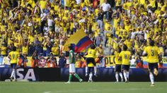 Colombian players celebrate their goal scored by midfielder Macnelly Torres (C) during their Brazil 2014 World Cup South American qualifier match against Bolivia, in Barranquilla, Colombia, on March 22, 2013. AFP PHOTO / Eitan Abramovich
