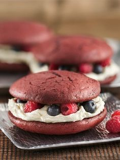 Tender, red velvet whoopie pies, stuffed with creamy white buttercream and beautiful berries make these hand-held sweets real crowd-pleasers. Want bite-sized pies? Use 2 tablespoons of batter and bake 8 to 10 minutes or until set.