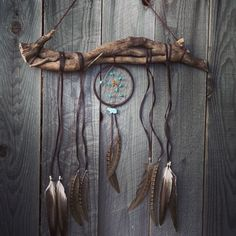 DreamCatcher Boho Wall Hanging Decor Feather Wind Chime Tribal Turquiose Home Decor. DreamCatcher - Boho Wall Hanging And Decor Feather Wind Chime With Tribal Home Decor Flair. This bohemian wall hanging has a Dreamcatcher that has turquoise and vintage Native American animal fetish charms woven in it. According to Native Americans good dreams are permitted to go through the center hole of the Dreamcatcher and bad ones will be trapped in the webbing. Turquoise - is also a powerful crystal...