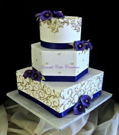 Elegant Ivory and Gold Wedding Cake with Purple Calla Lilies | Flickr - Photo Sharing!