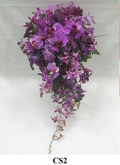 Purple cascading bouquet www.tablescapesbydesign.com https://www.facebook.com/pages/Tablescapes-By-Design/129811416695
