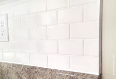 kitchen white subway tile backsplash http://howtonestforless.com/2014/10/14/install-kitchen-backsplash/