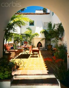 Tiled Courtyard with Outdoor Fireplace by 	Fernando Bengoechea