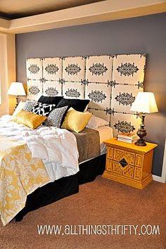 Maak je slaapkamer af door het hoofdbord bijvoorbeeld te bekleden met dezelfde stof als je gordijnen of kies juist voor een contrast.
