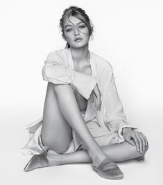 Gigi Hadid for Stuart Weitzman SS17. in the Mulearky Slide  Available in pink and gold  http://www.theseptember.com/stuart-weitzman-mulearky-satin   http://www.theseptember.com/stuart-weitzman-mulearky-slide-gold
