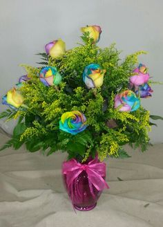 Beautiful Rainbow Roses...yes They Are Real. Call Log Cabin Florist Bakersfield  California