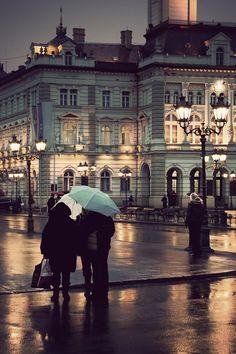 Rainy night social rain city lights people buildings shopping walk