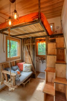 Austin Tiny House interior In Love with that couch swing!!! this is purrfect! i could see the cats now running up and down those alternating stairs!