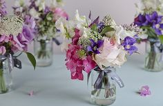 We can do better than this, but I love the sweet peas and other spring flowers. Wild at Heart jam jar flowers Jam Jar Flowers, Table Flowers, Small Flowers, Beautiful Flowers, Wedding Venue Decorations, Wedding Table Centerpieces, Flower Decorations, Centrepieces, Wedding Tables