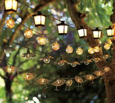 Pottery Barn string light cords virtually disappear into the trees