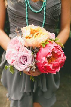 big blooms, gray dress, aqua pearls.