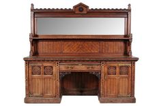 A Victorian Gothic oak, walnut, ebonised
