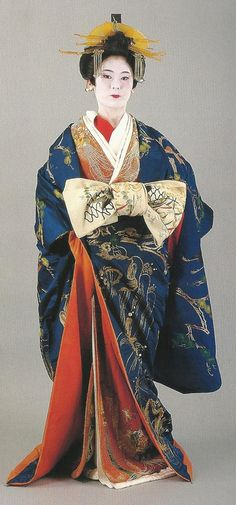 Scan A1.  Scans from book: 300 years of Japanese women's appearance, kimono, kanzashi etc.ISBN4-87940-541-8. An incredible set of shots of a tayuu (courtesan) dress. The opulant heavily-embroidered uchikake (outer kimono) and obi appear to date to the mid-19th century. Images scanned by Lumikettu of Flickr