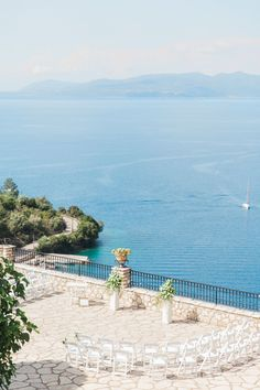 Destination wedding ceremony in Meganisi, Greece with stunning terrace location and panoramic sea view of Lefkada, Scorpios and the Greek mainland. By planner Lefkas Weddings with Maxeen Kim Photography