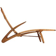 "The oak and cane ""Dolphin"" folding chaise, a rarity. Designed by Hans Wegner"