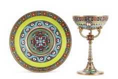 AN IMPERIAL RUSSIAN SILVER PLIQUE-A-JOUR, GUILLOCHE AND CHAMPLEVÉ ENAMEL SHERBET CUP WITH MATCHING UNDERPLATE, KHLEBNIKOV, MOSCOW, 1899-1907.