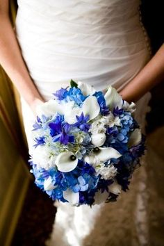 Blue bouquet- blue hydrangea, blue delphinium and blue triteleia mixed with white tulips and calla liies