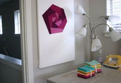 Several designs on how to make your own design wall.  Would work batter than the floor. :-)