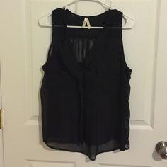 Sheer Sleeveless Black Button Down Top Sheer black top. Sleeveless, button down. Two front pockets. Slightly longer in the back. Tops Blouses