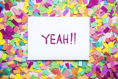 Yeah! text on paper and colorful party confetti background party concept | free image by rawpixel.com