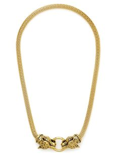 This glamorous collar flaunts two gilded leopard heads connected by a shimmering gold bit ring and luxe mesh chain for a chic update on a classic baroque look.